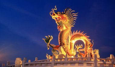 Chinese dragon statue at twilight time