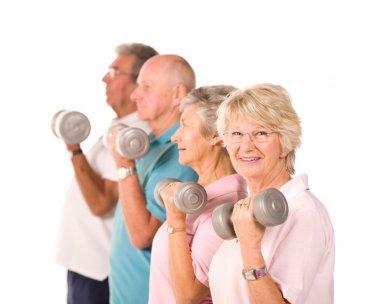 Senior older people lifting weights