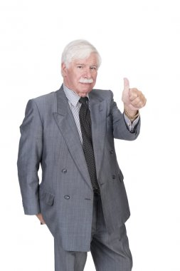 Old man in suit and gray hair with one hand showing thumbs up