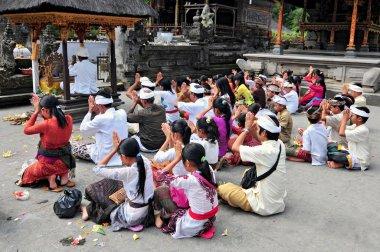 People praying at holy spring water temple Puru Tirtha Empul.