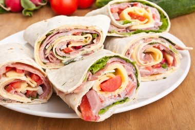 Wrapped tortilla sandwich rolls cut in half stock vector