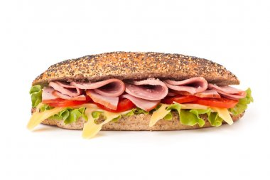 long whole wheat baguette sandwich with lettuce, tomatoes, ham,