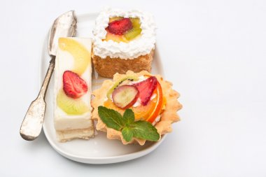 Group of fruit tarts on a white background
