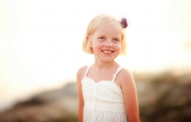 Cute little girl with a flower in her hair