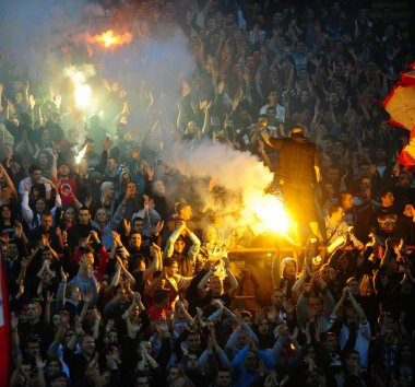 Soccer or football fans using pyrotechnics