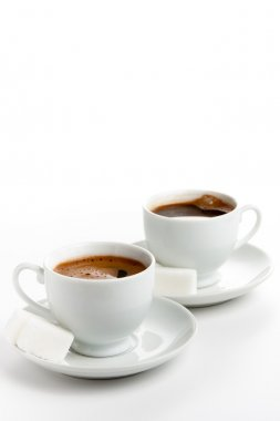 Two cups of coffee with sugar cubes