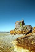 Fotografie Das kleine Gebäude am Rande des Meeres