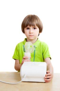 Little child with inhalation
