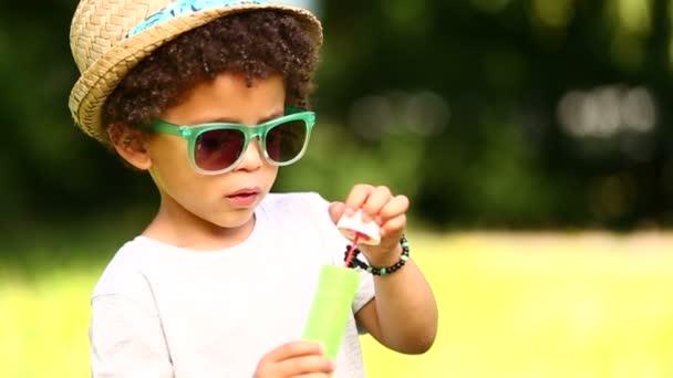 Boy having fun blowing soap bubbles