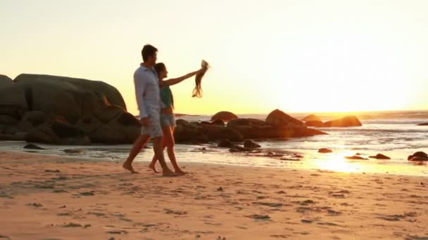 Couple in love is walking on the beach