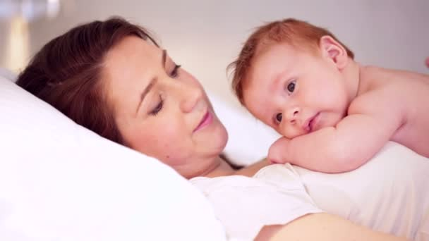 Mother With Baby In Bed