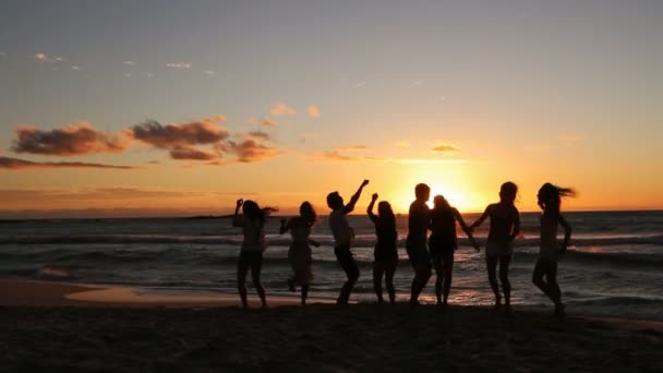 People dancing at the beach