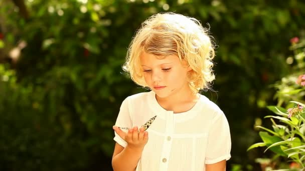 Girl in nature holding a rice paper butterfly