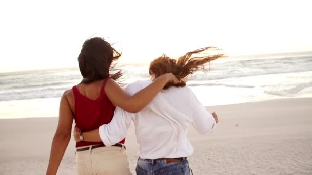 Best friends walking down the beach