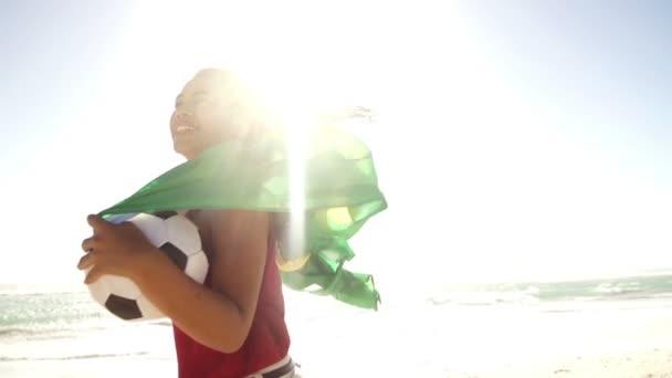 Brazilian woman with flag and football