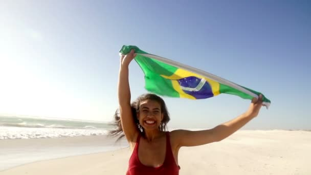 Brazilian girl jumping with flag