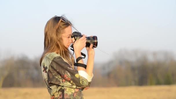 Girl with camera sunlight