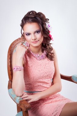 attractive girl with ornaments in the art soutache in a pink dre