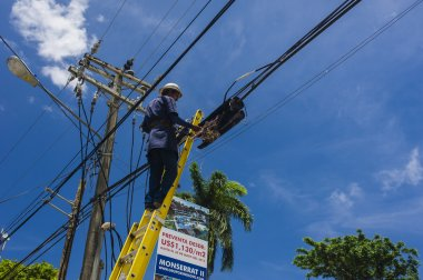 Man working with electricity power pole