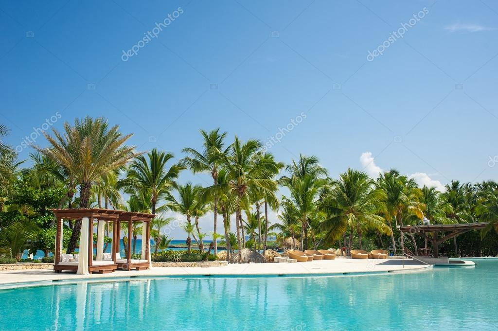 Outdoor resort swimming pool of luxury hotel.