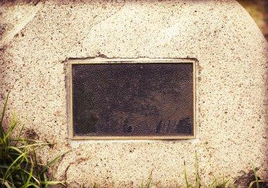 Weathered plaque