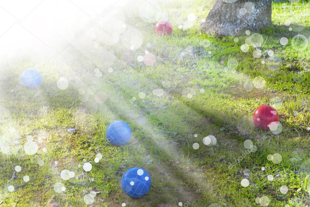 Red and blue balls in grass