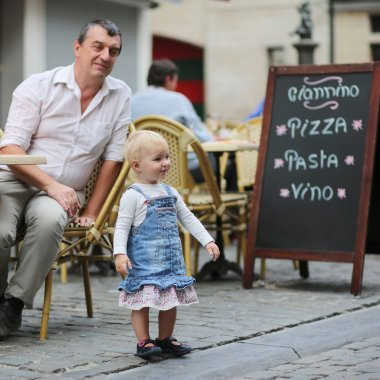 Father and his daughter in Italian cafe