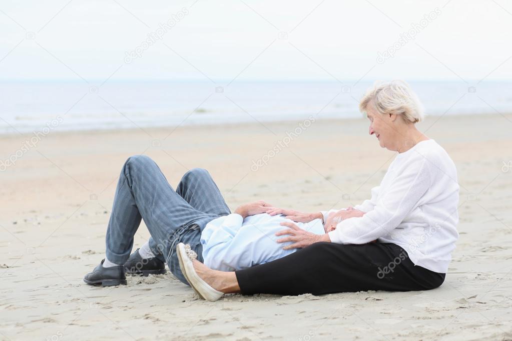 Senior loving couple looking at the ocean
