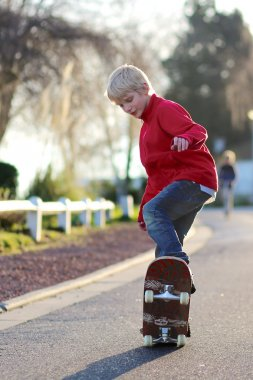 Teenager boy learning to balance on skateboard