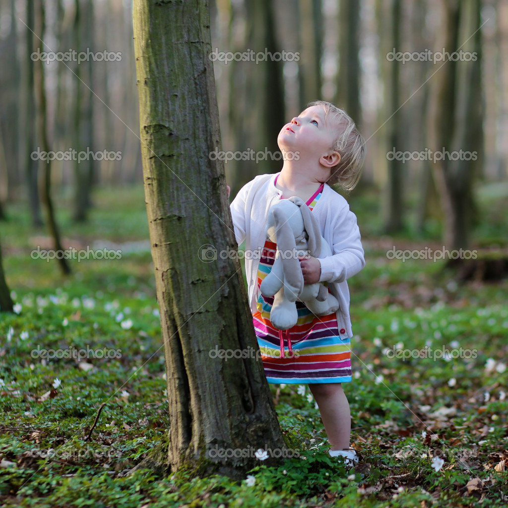 Фотообои Girl playing in spring forest on a sunny day