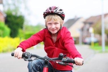 School boy riding his bike