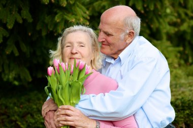 Man giving tulips to his wife