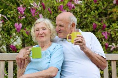 Couple drinking tea in the garden
