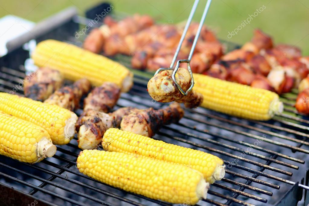 Assorted meat and vegetables on barbecue grill