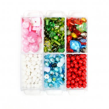 Assortment of beautiful glass beads in a box stock vector