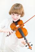 Fotografie School boy playing violin