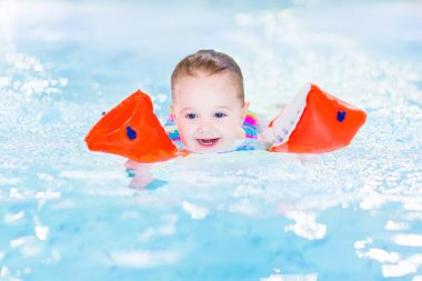 Toddler girl in a swimming pool