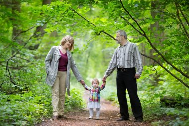Grandparents hiking with their baby grand daughter