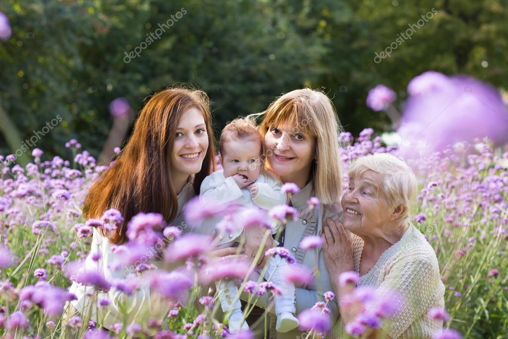 Four generations of beautiful women in a field