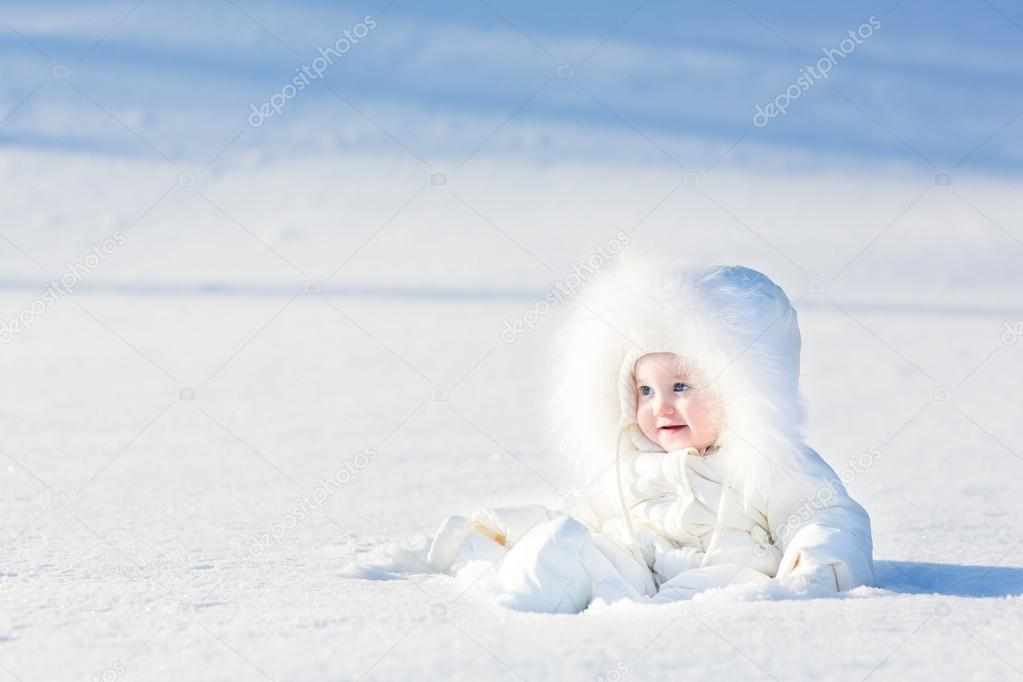 74564561d905 Little baby girl sitting in white snow — Stock Photo © FamVeldman ...