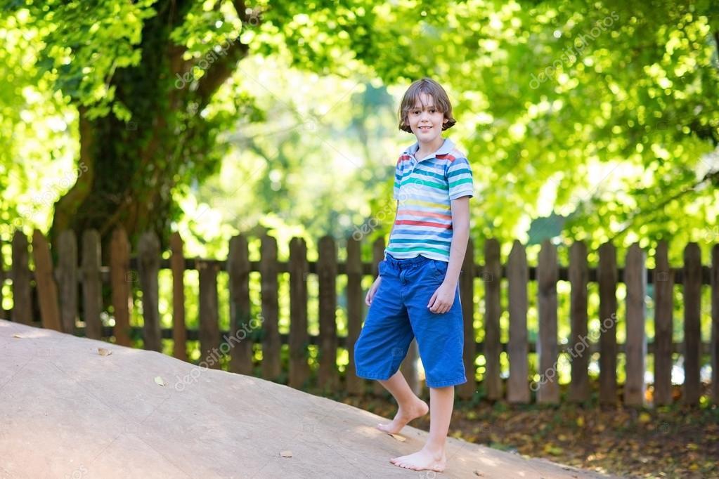 Boy running on a playground