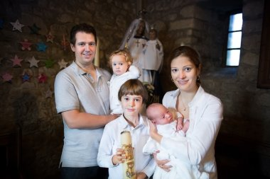 Family celebrating the baptism of their newborn baby