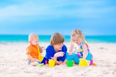 Three kids playing on a beach