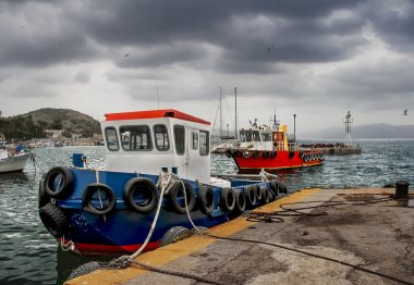 Fishing boats in a rainy day