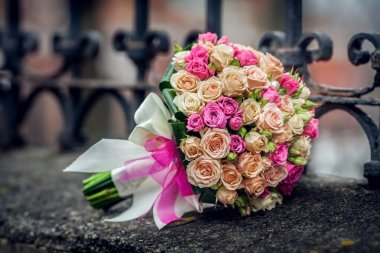 Wedding bouquet of roses lying on the street