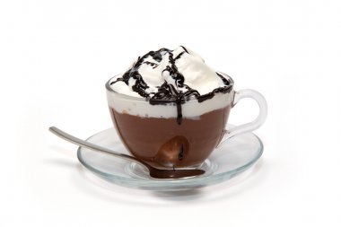 Hot chocolate with cream and syrup in glass cup