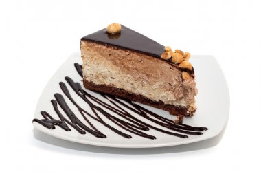Nougat cake with chocolate, hazelnuts and topping isolated