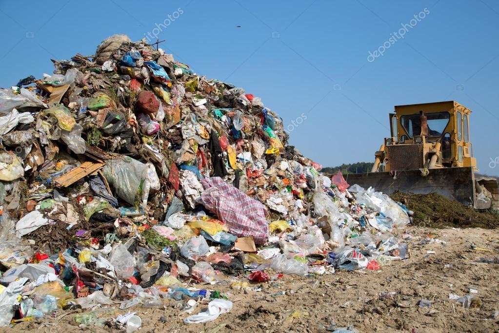 The old bulldozer moving garbage