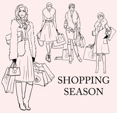 Stylish women with shopping bags