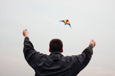 Man controls a kite